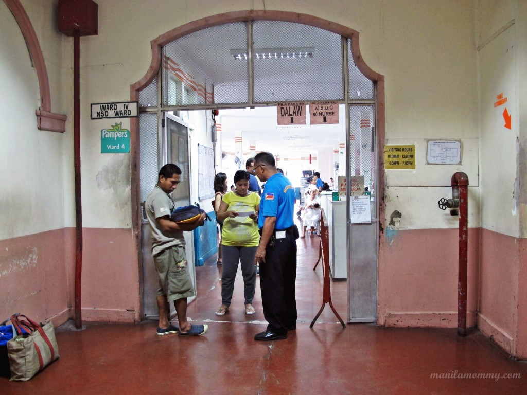 Visitors cannot enter the ward. moms are called by their patient number and then meet their visitors at the entrance. This pic is of a mom and her baby being discharged. Their papers are checked first before they are released.